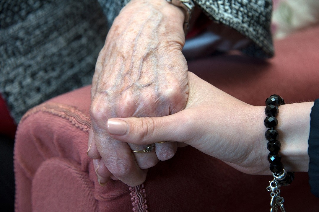 Holding hands - offering support in health and social care