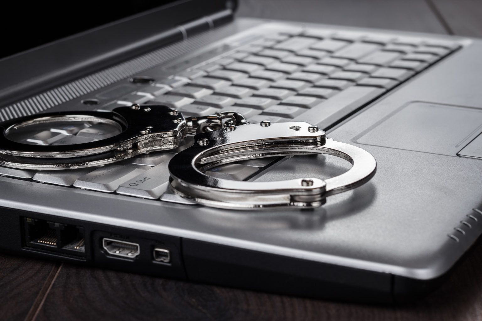 /assets/Uploads/Crime-Criminal-Justice/School-of-Law-CCJ-handcuffs-on-laptop-cyber-crime-concept-P3J7FHN-1.jpg