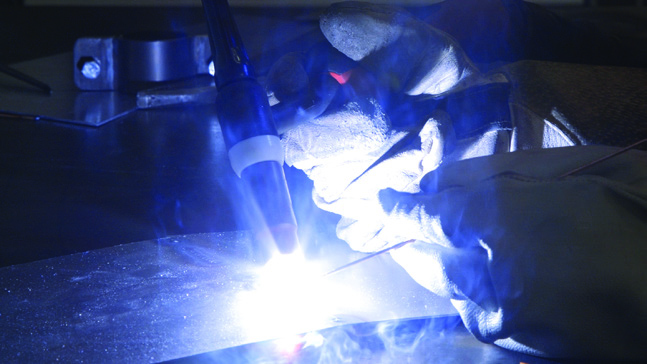 An NCME student TIG welding at the University of Bolton