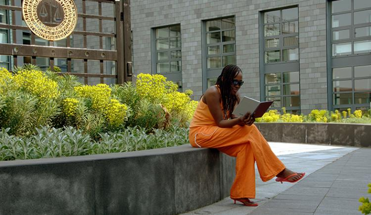 University of Bolton Senate House Garden with Student Reading